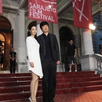 Lun Mei Gwei, Actress from the film BLACK COAL, THIN ICE with Yi'nan Diao - Director of the film BLACK COAL, THIN ICE at Red Carpet, National Theatre, Sarajevo Film Festival, 2014 (C) Obala Art Centar