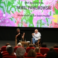 Director Pawel Pawlikowski and moderator Tue Steen Müller, Q&A session, Tribute to Pawel Pawlikowski, Meeting Point Cinema, 25th Sarajevo Film Festival, 2019 (C) Obala Art Centar